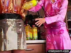 lesbians get wet and messy in oil catfight
