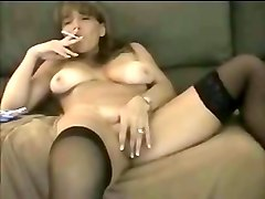 smoking busty brunette milf in stockings flashed her twat as well