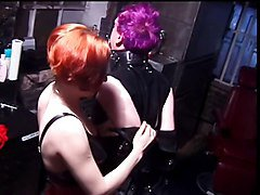 Femdom secures male in leather bondage restraints