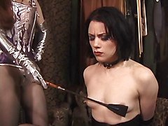 Beautiful young brunette is restrained and used by mistress