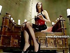 Mistress in tight leather costume torturing poor man slave in vio