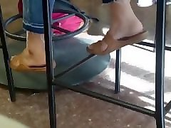 candid latina feet in cafeteria