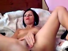 slim girl with purple hair fucks herself with a toy cock
