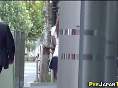 urinating asian in park