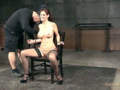 hot brunette milf babe is bound to the chair and fed with dicks