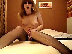 trashy french slut in nylon stockings masturbates with dildo