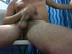 cigarette smoking twink strokes his shaved rod