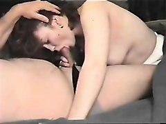 attractive busty redhead girl with large breasts sucking on