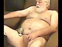 solo leather bear jerking his hard cock