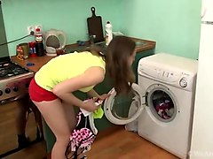 Hairy milf masturbating on a washing machine