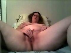 sexy mature wife in glasses opens her twat and masturbates