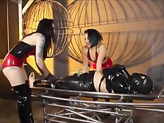 Two latex mistresses electro torture slave