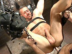 Cock hungry leather studs play in a dark basement