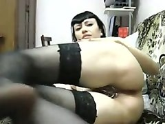 black haired chick in nylon stockings stretching her pussy lips with fingers