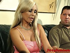 Busty babe fucked with strapon by lezdom