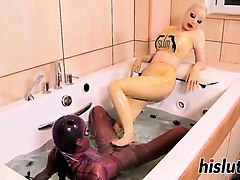 two latex-clad babes have some lesbian fun